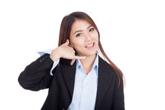 Young Asian businesswoman gesturing phone call Stock Photo