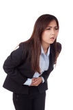 Young Asian businesswoman got  stomachache Royalty Free Stock Photos