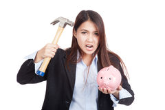 Young Asian businesswoman with hammer and  piggy bank Royalty Free Stock Photo