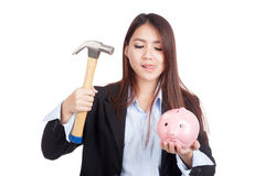 Young Asian businesswoman with hammer and  piggy bank Royalty Free Stock Image