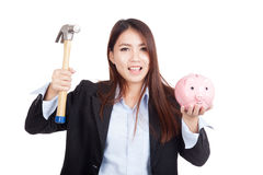 Young Asian businesswoman with hammer and  piggy bank Royalty Free Stock Photography