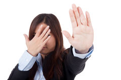 Young Asian businesswoman hide her face say no Royalty Free Stock Image