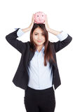 Young Asian businesswoman hold  piggy bank over head Stock Images