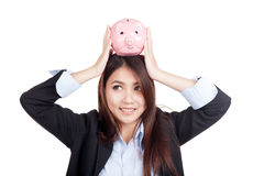 Young Asian businesswoman hold  piggy bank over head Stock Photography