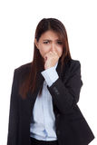 Young Asian businesswoman holding her nose because of a bad smel Stock Photography