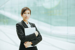 Young asian businesswoman. Holding a laptop Stock Photography