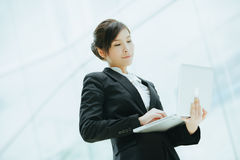 Young asian businesswoman holding a laptop Stock Image