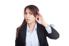 Young Asian businesswoman listen with hand on ear Royalty Free Stock Photography