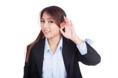 Young Asian businesswoman listen with hand on ear Royalty Free Stock Photo