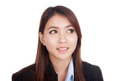 Young Asian businesswoman look away and smile Royalty Free Stock Photography