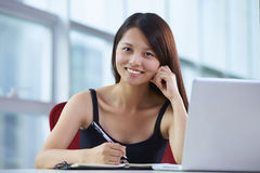 Young asian businesswoman in the office. Asian Business woman looking at camera  smile in the office Royalty Free Stock Image
