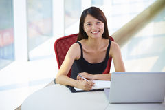 Young asian businesswoman in the office. Asian Businesswoman in office smile at camera sitting in the chair Royalty Free Stock Images