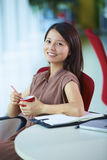 Young asian businesswoman in the office. Young asian woman looking at camera smile in the office smile Stock Photos