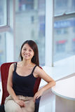 Young asian businesswoman in the office. Young asian woman looking at camera smile in the office smile Stock Photography