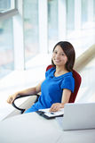 Young asian businesswoman in the office. Young asian woman looking at camera smile in the office smile Stock Image