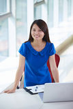 Young asian businesswoman in the office. Young asian woman looking at camera smile in the office smile Stock Images