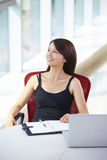 Young asian businesswoman in the office. Young asian woman looking out of the window in the office smile Stock Image