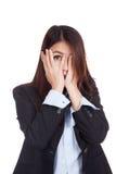 Young Asian businesswoman peeking though her fingers Stock Photos