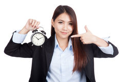 Young Asian businesswoman point to alarm clock Stock Photography