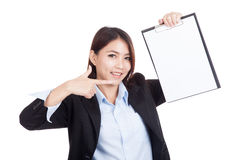 Young Asian businesswoman point to blank clipboard Stock Photos