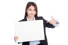 Young Asian businesswoman point to blank sign Stock Photos
