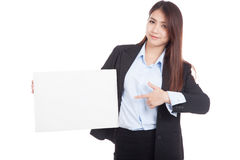 Young Asian businesswoman point to  blank sign Royalty Free Stock Image