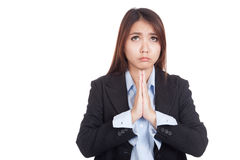 Young Asian businesswoman pray with unhappy face Stock Photography