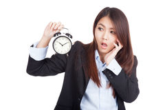 Young Asian businesswoman shock with alarm clock Stock Photography