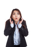Young Asian businesswoman shocked and look up Stock Photo