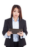 Young Asian businesswoman shocked with tablet PC Royalty Free Stock Photography