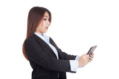Young Asian businesswoman shocked with tablet PC Stock Photo