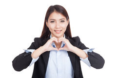 Young Asian businesswoman show heart hand sign Stock Photos