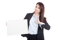 Young Asian businesswoman show OK with  blank sign Stock Photography