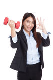 Young Asian businesswoman show OK with red dumbbell Royalty Free Stock Photo