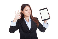 Young Asian businesswoman show ok with tablet pc Royalty Free Stock Images