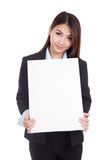 Young Asian businesswoman show  vertical  blank sign Royalty Free Stock Photography