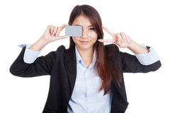 Young Asian businesswoman show victory sign and  blank card Royalty Free Stock Photography