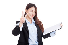 Young Asian businesswoman show victory sign with clipboard Stock Image