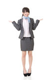 Young asian businesswoman shrugging Royalty Free Stock Photos