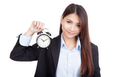 Young Asian businesswoman smile with alarm clock Royalty Free Stock Images