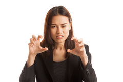Young Asian businesswoman with spooky hands gesture. Royalty Free Stock Images