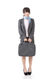 Young asian businesswoman standing with a handbag Royalty Free Stock Photography