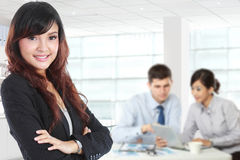 Young asian businesswoman standing with her secretary behind stock images