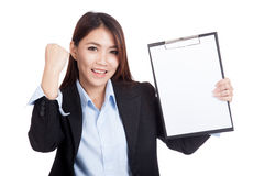 Young Asian businesswoman success with blank clipboard. Isolated on white background Royalty Free Stock Photo