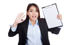 Young Asian businesswoman surprise with blank clipboard Stock Image