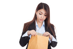 Young Asian businesswoman surprise look inside brown envelopes Royalty Free Stock Photos