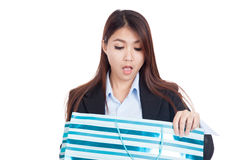 Young Asian businesswoman surprise look inside shopping bag Stock Photography
