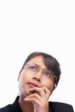 Young Asian businesswoman thinking Stock Photo