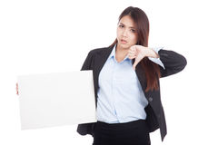 Young Asian businesswoman thumbs down show blank sign Stock Photo