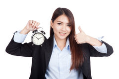 Young Asian businesswoman thumbs up with alarm clock Royalty Free Stock Photos